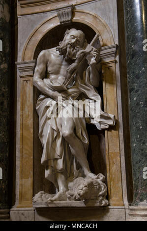 statue of an elderly man standing on a lion cradling jesus on the cross - stonework inside the dome duomo in the beautiful Italian city of Siena - Stock Image