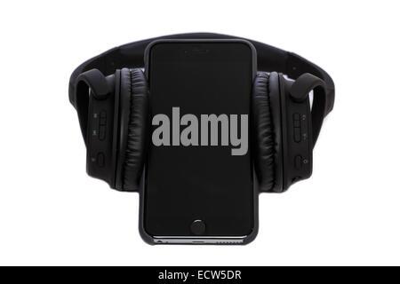 Bluetooth Headphones with iPhone 6+ - Stock Image