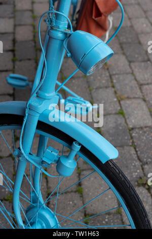 Blue painted bike, Vesteralen, Norway. - Stock Image