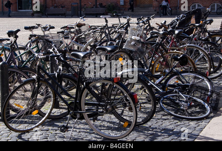 Bicycles parked and fallen in Copenhagen Denmark - Stock Image