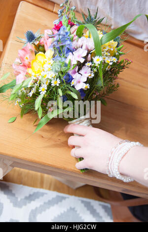 Bride,grows,after,bouquet,bridal bouquet,grab,hand,finger,beautiful,model,wrist,bra,jewelry,bracelet,beads,white,colorful,bloom, - Stock Image