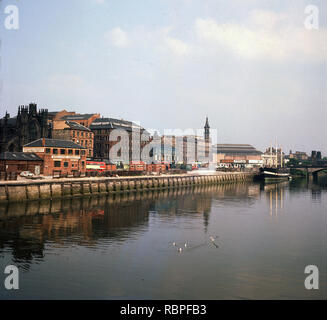 1960s, view of the River Clyde and the city of Glasgow, Scotland, UK from tihis era. Clyde Cargo Steamers can be seen in the picture. Also seen at the far corner is the 1864 clipper ship, the Carrick, which was used by the Royal Naval Volunteer Reserve Club (RNVRC) and remained on the Clyde until 1989 untile damaged by flooding. The second-longest river in Scotland, the Clyde was important for shipbuilding and trade in the British Empire. - Stock Image