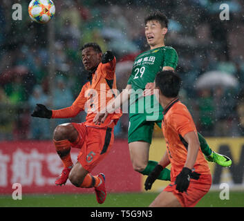 Beijing, China. 24th Apr, 2019. Ba Dun (C) of Beijing Guoan FC heads to score during the group G match between China's Beijing Guoan FC and Thailand's Buriram United at the 2019 AFC Champions League in Beijing, capital of China, April 24, 2019. Credit: Ding Xu/Xinhua/Alamy Live News - Stock Image