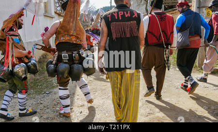 Turia, Bulgaria, 9 March 2019. Masquerade ritual Kukeri  to expel evil.  People from the village wear big bells and terrible costumes. - Stock Image