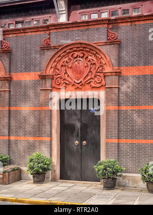 30 November 2018: Shanghai, China - Typical doorway , in the Xintiandi district of Shanghai, showing a mixture of Chinese and European influences. - Stock Image
