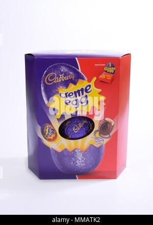 Cadbury cream egg Easter egg in box on neutral background - Stock Image