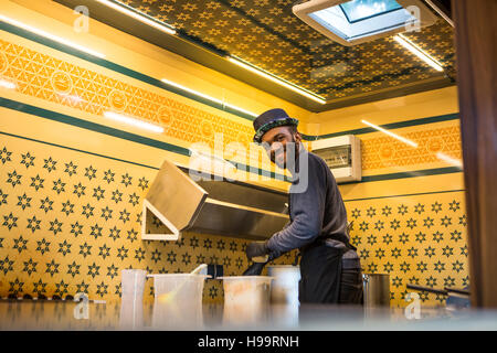 Food truck owner in his commercial kitchen - Stock Image