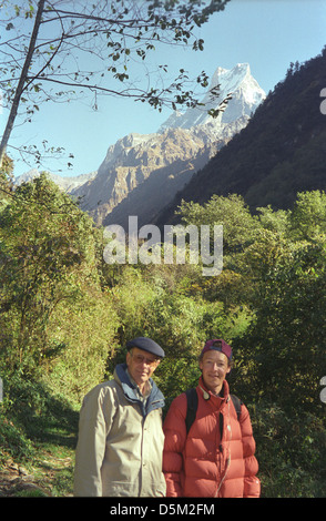 David Keith Jones and Mark in bamboo forest with view of Machhapuchhre on Annapurna circuit Chomrong Nepal Himalayas - Stock Image