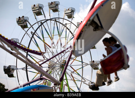 The Paratrooper and Ferris Wheel rides on the midway at Frisco Fest in Rogers, Arkansas, U.S.A. - Stock Image