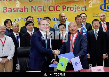 (190423) -- BASRA (IRAQ), April 23, 2019 (Xinhua) -- Photo taken on Feb. 27, 2019 shows officials from Basrah Gas Company and China Petroleum Engineering and Construction Corporation (CPECC) attending a ceremony to sign cooperation agreement in the southern province of Basra, Iraq. Through the Belt and Road Initiative, the Chinese company can offer financial, technical support and expertise for Iraqi government in reconstructing oil fields and increase their production, said Wang Xianghui, project director of Rumaila in China Petroleum Engineering and Construction Corporation (CPECC). (Xinhua/ - Stock Image