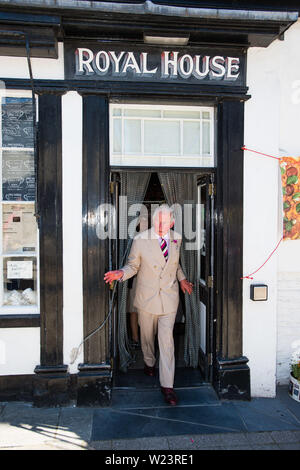 Machynlleth Powys Wales. July 05 2019  Prince Charoes emerges from the 'Royal House', an old shop in Machynlleth, now a bakery. on the final day of hois annual summer visit to Wales  pohoto credit: Keith Morris / Alamy Live News - Stock Image