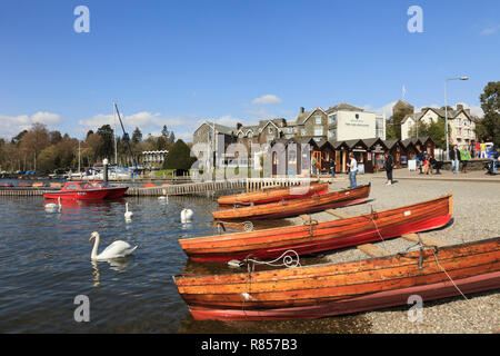 Wooden rowing boats for hire on Windermere lakeside in the Lake District National Park. Bowness on Wndermere, Cumbria, England, UK, Britain - Stock Image