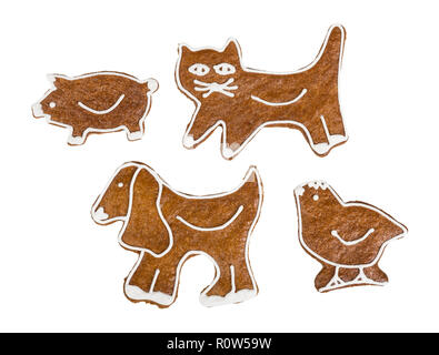 Cute gingerbreads set. In kitty, doggy, piggy, and chicken shape. Sweet Christmas cookies decorated by icing. Xmas, New year, Children's day, birthday. - Stock Image