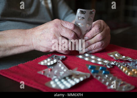 Senior man with all his medication - Stock Image
