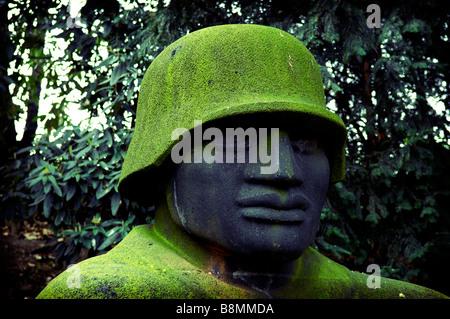 german soldier jupp rubsam sculpture stone statue 1928 dusseldorf war memorial deutschland germany travel tourism - Stock Image