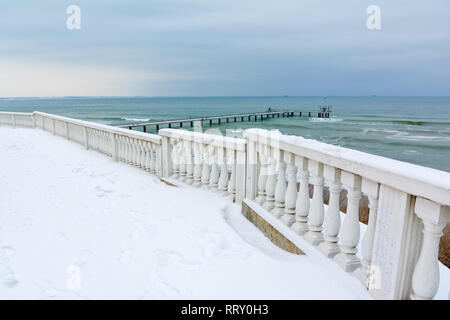 Snow Black Sea landscape in Burgas bay, Bulgaria. Burgas bridge in winter. - Stock Image