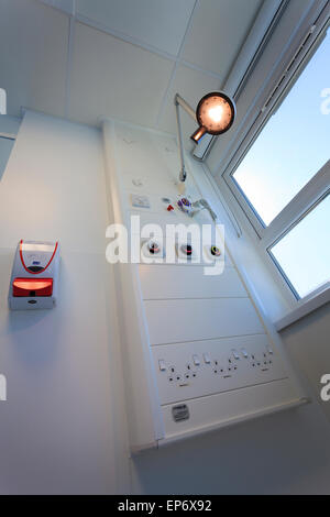 bedhead service systems in hospital ward with hand sanitiser - Stock Image