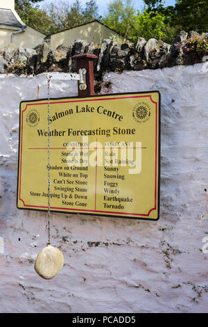 Weather Forecasting Stone joke and funny sign Ballacregga Corn Mill in Salmon Lake Centre. Laxey, Isle of Man, British Isles - Stock Image
