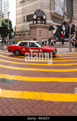 Red  taxi near Times Square in Hong Kong - Stock Image