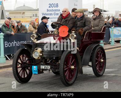 Mr Bernard Williamson driving a 1902 Wolseley, across the finishing line of the 2018 London to Brighton Veteran Car Run - Stock Image