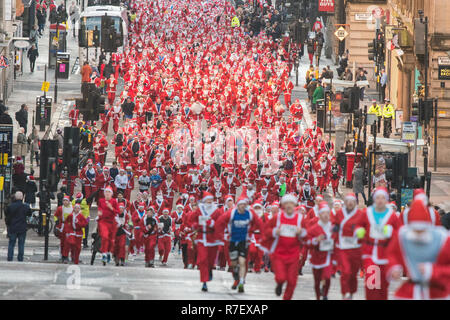 Glasgow, Scotland, UK - 9 December 2018: thousands of santas running through the streets of Glasgow today in the annual Santa Dash - Stock Image