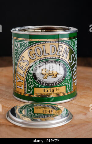 Lyle's Golden Syrup in its distinctive green and gold tin marketed since 1885 the worlds oldest unchanged brand packaging - Stock Image