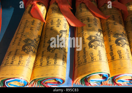 Fresh-printed prayer flags for sale at Ganden Monastery, outside Lhasa, Tibet, China - Stock Image