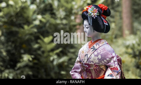Wolfsburg, Germany, July 8., 2016: Close-up of a traditional Japanese porcelain doll with a colorful silk kimono with embroideries - Stock Image