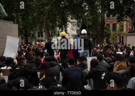 London, UK. 16th June 2019. Around 1000 demonstrators protest against the Extradition Law by the Hong Kong Government and its leader, Carrie Lam on Parliament Square, London, UK demanding British help in protecting freedom. The law would allow transfer of those suspected of crime, including political dissent, to be transferred to China. Credit: Joe Kuis / Alamy - Stock Image