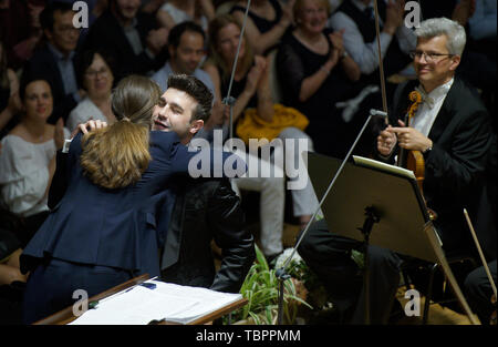 Prague, Czech Republic. 02nd June, 2019. Australian-British conductor Jessica Cottis, left, hugs with Spanish trumpeter Manuel Blanco, during a concert with the Prague Radio Symphony Orchestra within the 74th Prague Spring international music festival on June 2, 2019, in Prague, Czech Republic. Credit: Michaela Rihova/CTK Photo/Alamy Live News - Stock Image