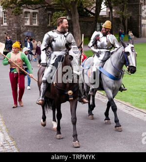 Two  mounted Knight in full Armour making  their way to an English Heritage Jousting Tournament at Dover Castle,  August 2018 - Stock Image