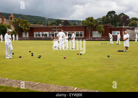 Senior men and women of Sidmouth Bowls Club playing bowls. - Stock Image