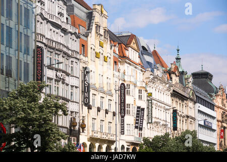 Shop facades and banners in Wenceslas Square, in the new town of Prague, Czech Republic - Stock Image