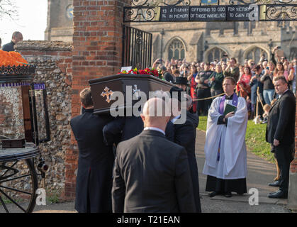 Braintree, Essex, UK. 29th Mar 2019.  Funeral of Prodigy frontman Keith Flint at St Mary's Church in Bocking attended by hundreds of his fans The coffin enters the church Credit: Ian Davidson/Alamy Live News - Stock Image