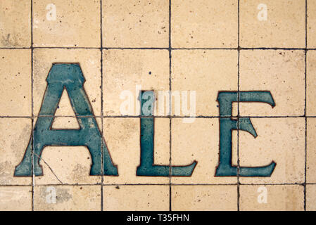 Tiles on the outside of a historic hotel (Pub) or bar in Surry Hills, Sydney advertise the type of beer available, Ale. - Stock Image