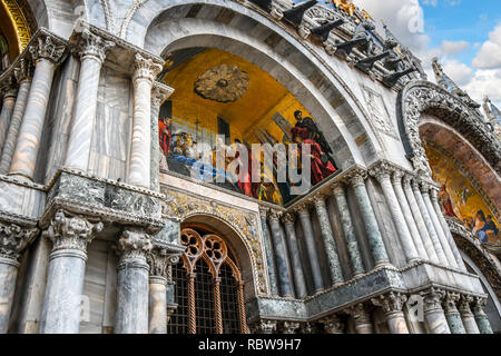 Golden mosaics adorn the facade of the Patriarchal Cathedral Basilica of Saint Mark, commonly known as Saint Mark's Basilica, in Venice, Italy - Stock Image