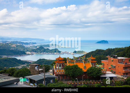 Magnificent views of the old Chinese temple and the ocean coast from the Jiufen village on November 7, 2018, in Jiufen, Taiwan - Stock Image