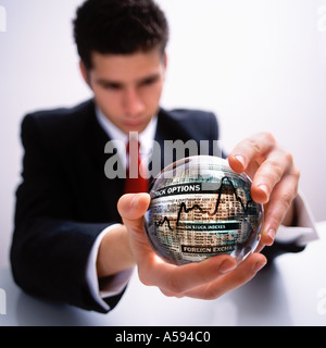 BUSINESSMAN WITH CRYSTAL BALL STOCK-MARKET WALL-STREET - Stock Image