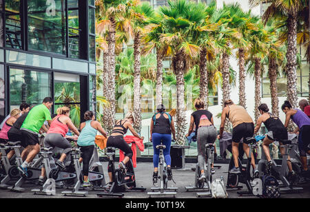 Funchal,Madeira/Portugal-05.09.2018. Outdoor stationary bike spinning class on the streets on Funchal, Madeira Island. - Stock Image