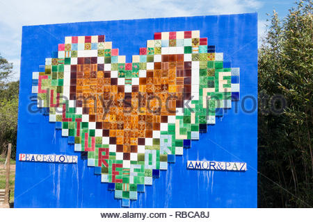 love heart made from a collection of coloured tiles, spelling out 'culture for life'. Buddha Eden Gardens Portugal - Stock Image