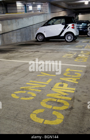 Compact car in parking garage - Stock Image
