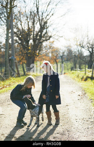 Girls with dog - Stock Image