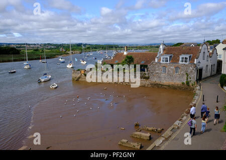 Topsham, Devon, UK. Tourists walk along the River Exe estuary in Topsham - Stock Image