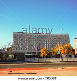Poznan, Poland - October 31, 2018: Mercure Hotel building and the Kaponiera tram stop in the city center. - Stock Image