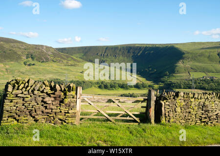 The Pennine Way runs above Torside Clough seen across the Longendale Valley in Crowden, Derbyshire, England, UK - Stock Image