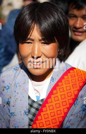 Bhutanese woman wearing traditional kira and shawl at Black-necked Crane Festival in Gangte Monastery, Phobjikha - Stock Image