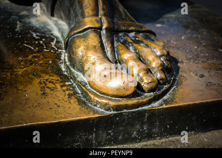 Split, Croatia - September 25, 2017 - The statue of Grgur Ninski big toe rubbed shiny by tourists who rub it for good luck in Split, Croatia - Stock Image
