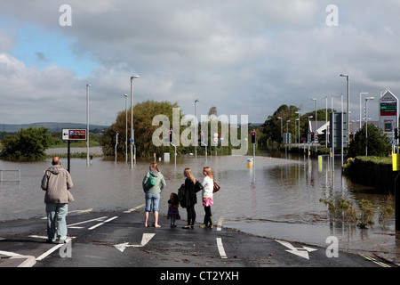 People look in disbelief as Weymouth gets flooded Prior to the 2012 Weymouth Sailing Olympics with Roads Underwater - Stock Image