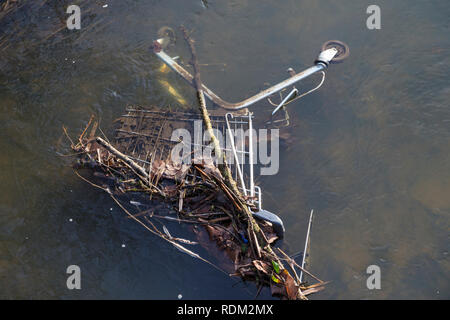 trolley dumped in a river, uk - Stock Image
