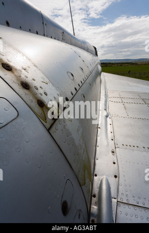 Retired MiG-21 fighter aircraft, close up on rusty panels and rivets on fuselage - Stock Image